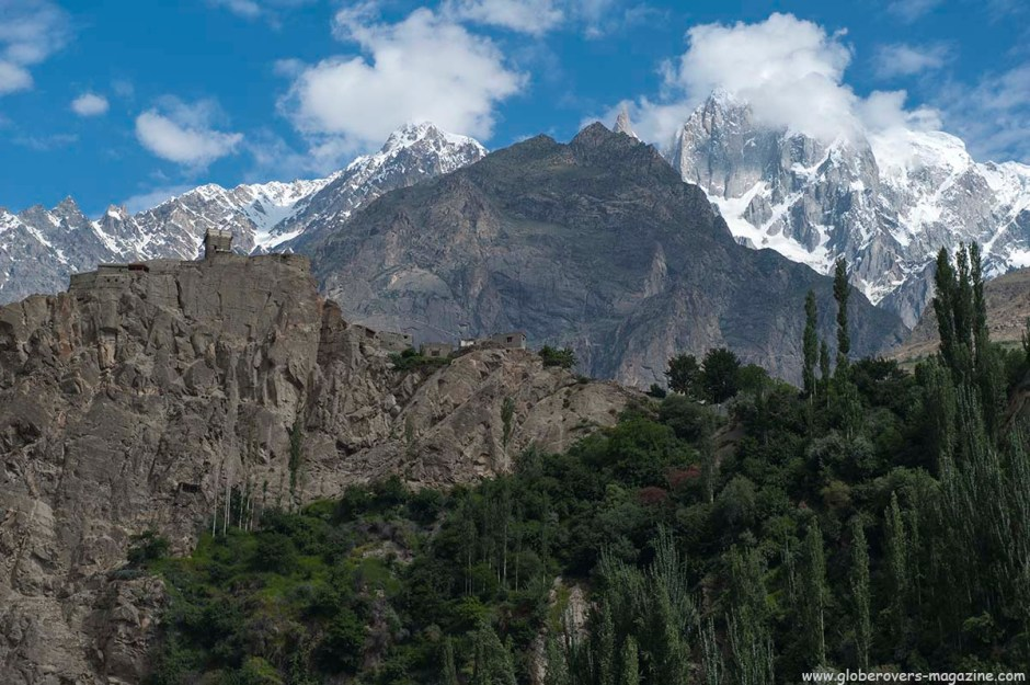 Altit Fort stands in front of peaks near Ultar Peak seen from KKH highway, Lower Hunza Valley, PAKISTAN