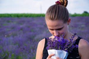 woman smelling lavender in lavendar field Unforgettable scent of perfection