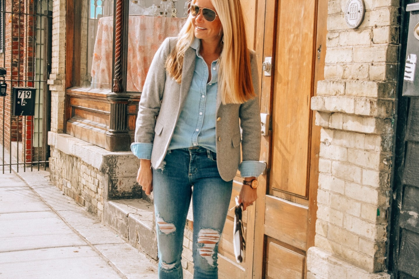 Casual chambray shirt with distressed denim for a Fall work look