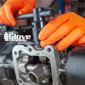 Disposable Gloves in use mechanics gear box.