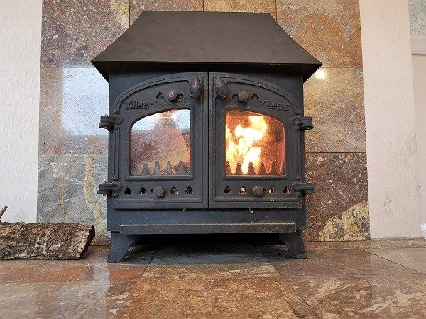 traditional wood burner installation in Chard