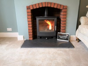 Brick fireplace and stove installation.