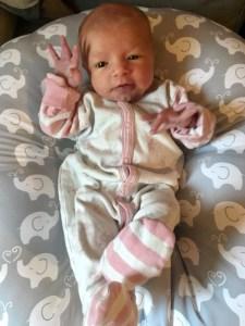 newborn waving