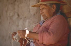 A chilean woman knitting.