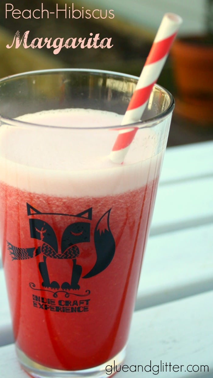This frozen peach hibiscus margarita is perfect for sipping in the springtime sunshine. Make yourself one this weekend!