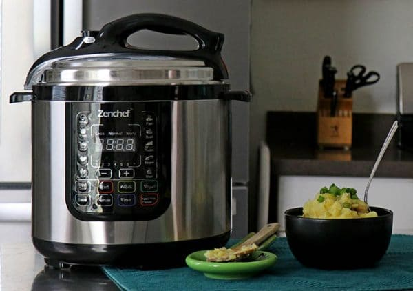closeup of ZenChef Multipurpose Pressure Cooker in a kitchen beside a bowl of vegan colcannon