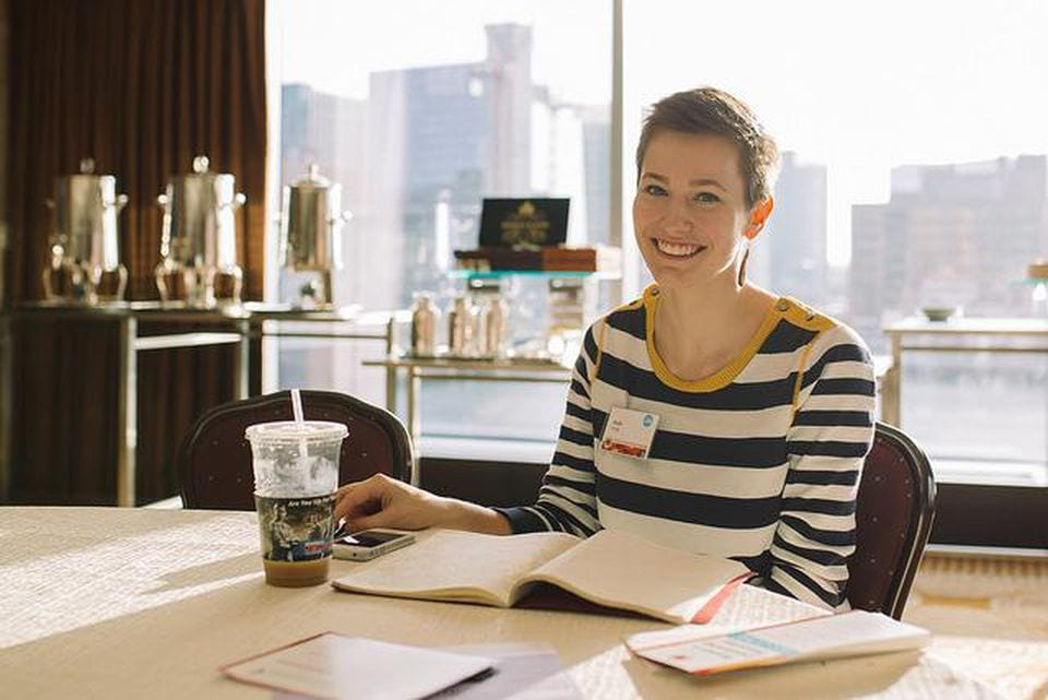 https___blogs-images.forbes.com_womensmedia_files_2018_07_Photo-woman-smiling-at-desk-Flickr-Jonny-Yao