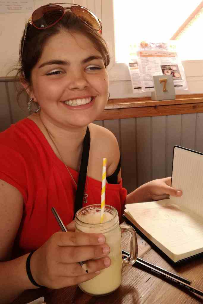 Bethany enjoying a milkshake in the Mountain Cafe in Aviemore, the perfect place to eat gluten free in the Cairngorms