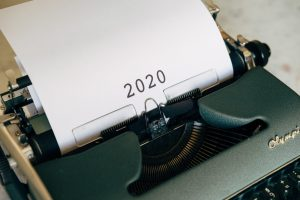 """a typewriter with """"2020"""" printed onto the paper"""
