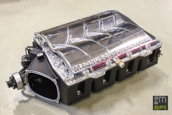Magnuson Superchargers' TVS 2300 Heartbeat blower will become the source of boost for our G8 GXP test car. Good for an additional 125 hp over that of a stock LS3 engine with just 6-psi., this particular example used for this test features a polished housing lid for added bling.