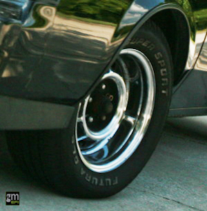If you look closely at the OEM wheel, you see a ridge in wheel lip. As Brian tells us, the OEM wheel was essentially the same wheel used in the FWD Rivera T-Type Turbo of the mid-80s, just that the center section and wheel were reversed to fit the RWD G-body Regal's backspacing. All that ridge is there to do, is collect brake dust and moisture, making them more difficult to clean and more susceptible to rust and pitting.
