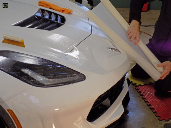 Albert laying out the PPF front bumper on Kenny Kneps's 2016 Corvette Z06
