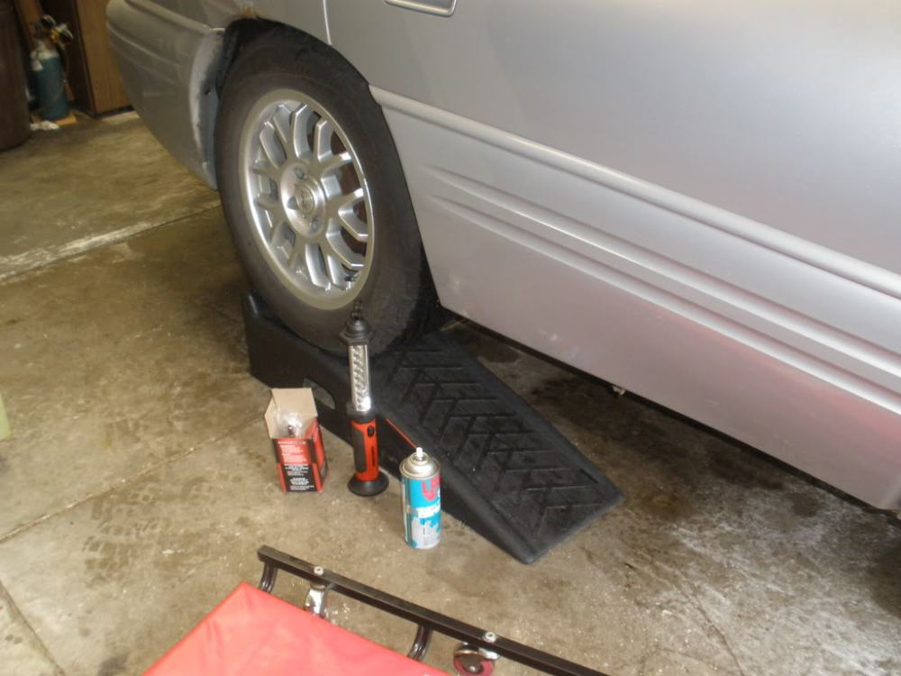 medium resolution of open your hood and locate the fuel rail then locate the cap and remove it