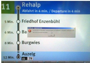 Image of the new station information system in some of Zurich's tramways with a Windows GPF on top of the display