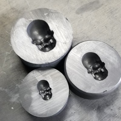 3 skull molds in graphite