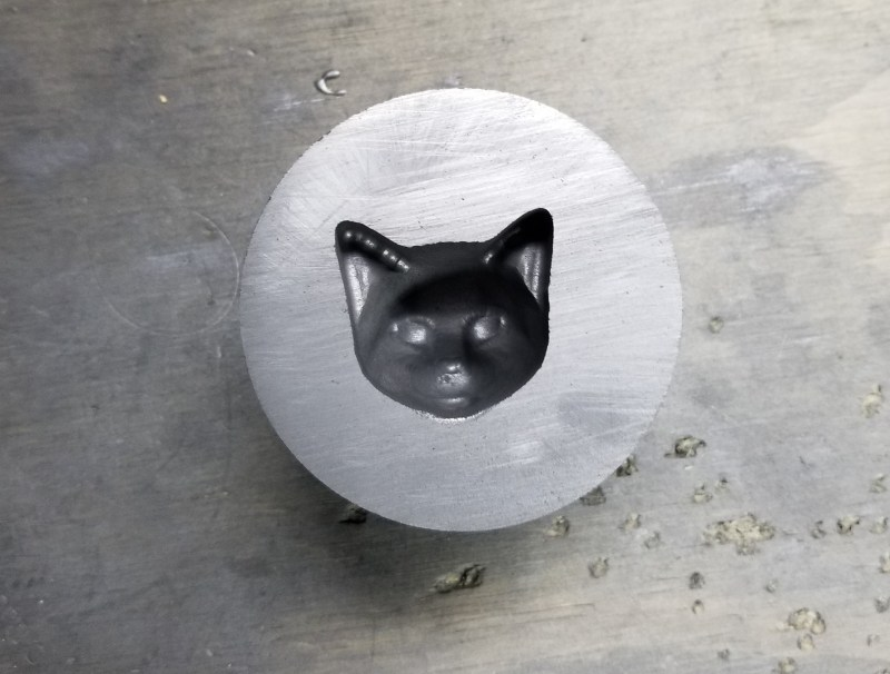 This is our Graphite Cat Face Mold