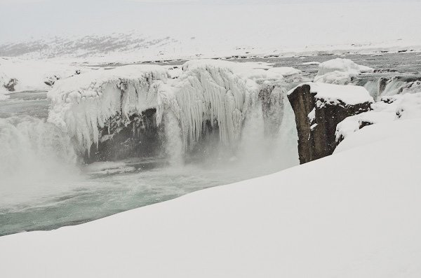 Goðafoss, the waterfall of the Gods, half frozen over.