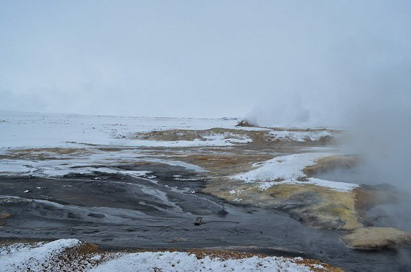 The geothermal fields of Krysuvik-Seltun where you can see steam fissures and boiling mud pits.