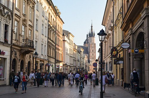 The people walking through Floriańska Street, one of the most famous streets in the city.