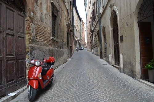 The only sign of life in Ancona is that at some point someone used this scooter.