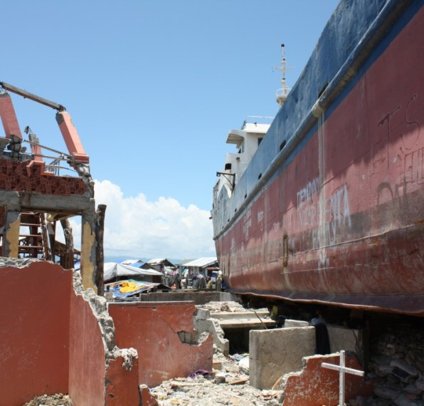 Multiple cargo ships and containers came ashore during the typhoon in Barangay Anibong