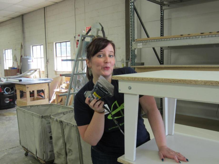 Volunteer sanding a table