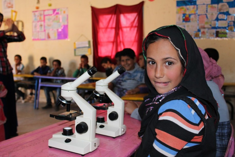 Tamazight girl learning to use a microscope