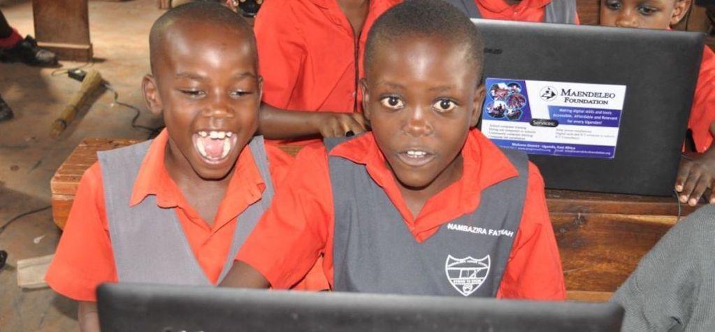 Ugandan students looking at a computer