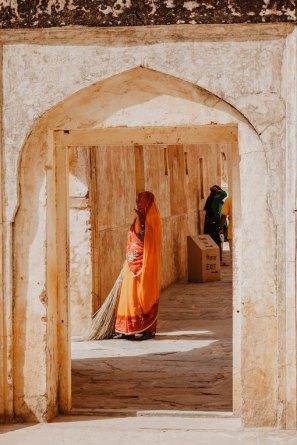 woman standing in walkway