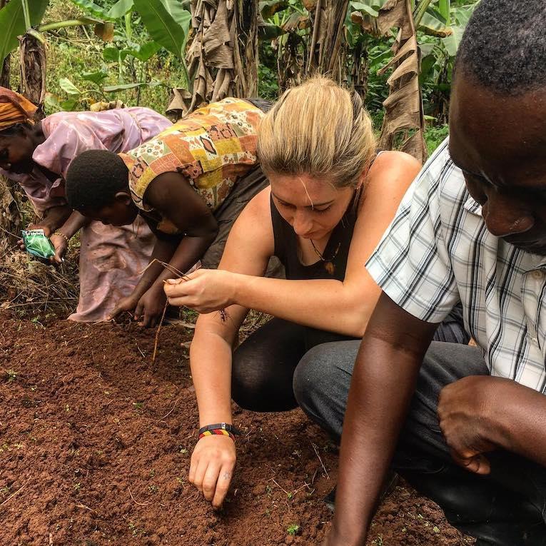 people planting seeds in soil in uganda