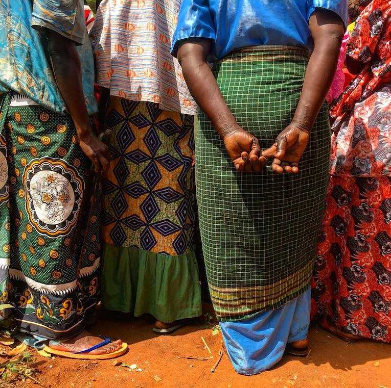 people wearing different fabrics and patterns in uganda
