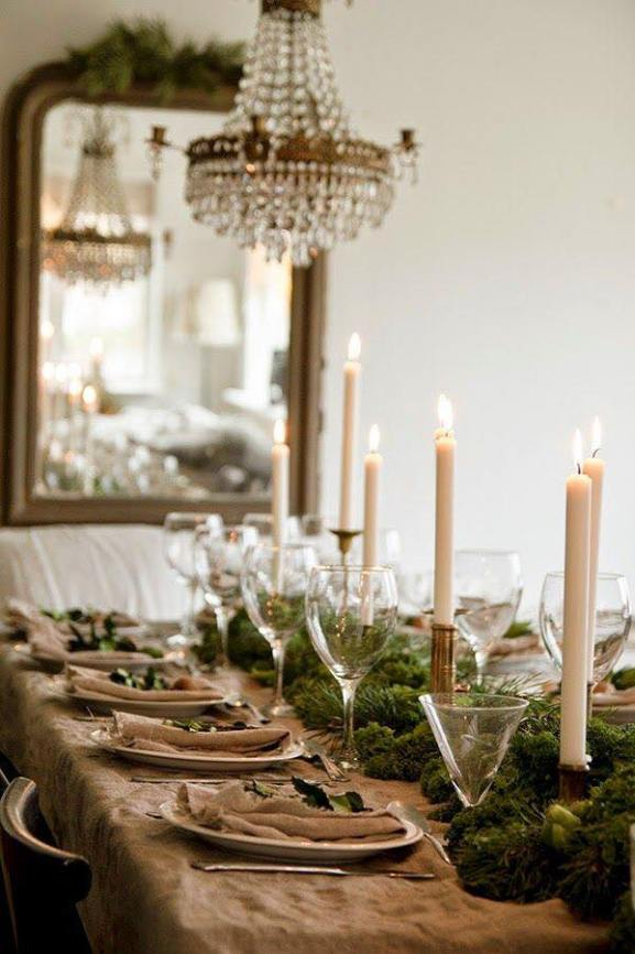 Candle light, texture, chandelier and mirror, with evergreens. Lovely, even by day.