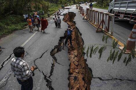 the road divided into two half with the impact of earthquake in Nepal