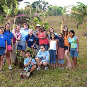Volunteers and locals planting trees in Costa Rica