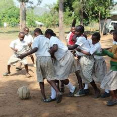 Students playing soccer in Kenya