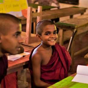 Young monk smiling at the camera
