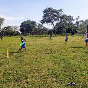 Boys playing cricket in Uganda