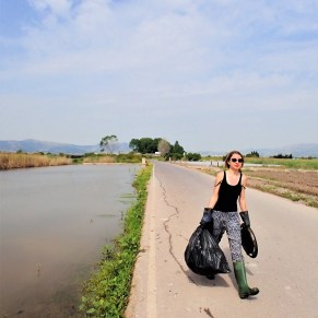 Volunteer carrying garbage cleaned up out of a wetland in Spain