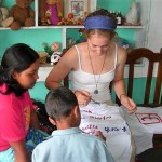 Children and a volunteer doing crafts