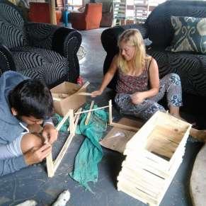 Volunteers building wooden boxes