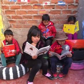Children reading in Peru
