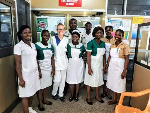 Medical intern with hospital staff