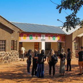 Volunteers outside of a school in Zambia