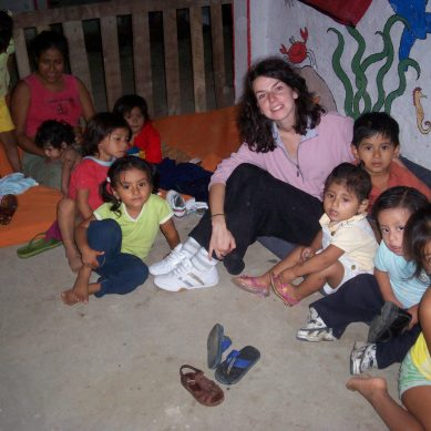 Volunteer sitting with kids at a children's home