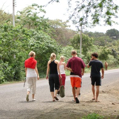Volunteers walking down a road in Ecuador