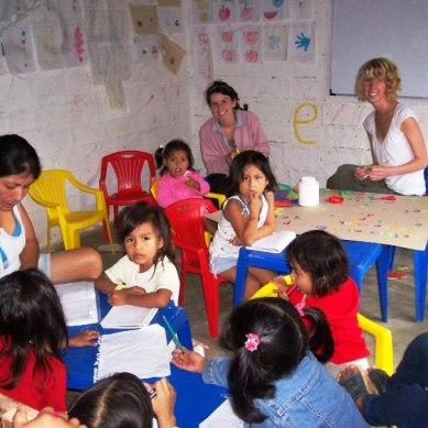 Volunteers teaching at a children's home