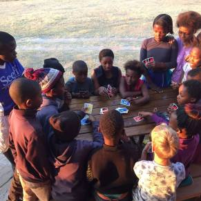 Group of children playing card games