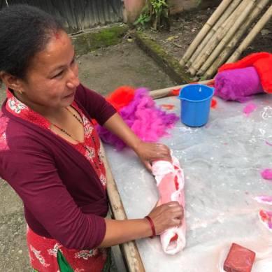 Nepali woman making crafts