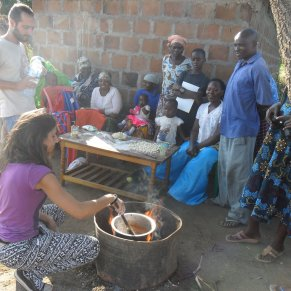 Volunteer cooking with locals in Tanzania