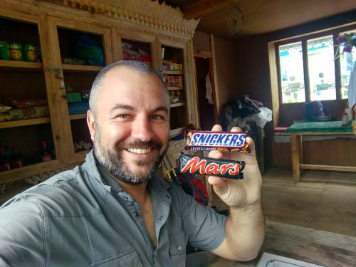 Justin with candy bars in a tea house in Nepal